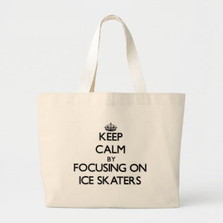 Keep Calm by focusing on Ice Skaters Tote Bags