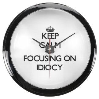 Keep Calm by focusing on Idiocy Aquarium Clocks