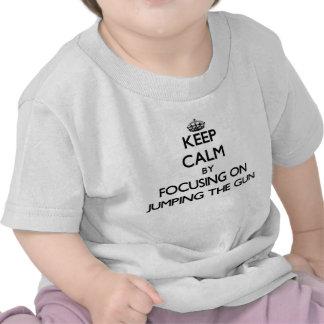 Keep Calm by focusing on Jumping The Gun T-shirts