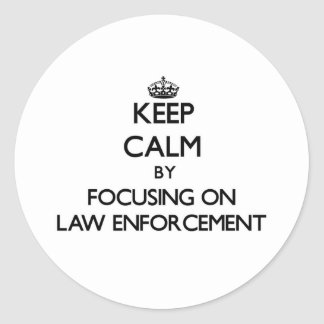 Keep Calm by focusing on LAW ENFORCEMENT Round Stickers