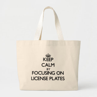 Keep Calm by focusing on License Plates Tote Bags
