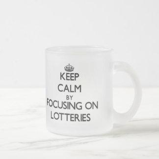 Keep Calm by focusing on Lotteries Coffee Mugs