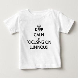 Keep Calm by focusing on Luminous Tshirts
