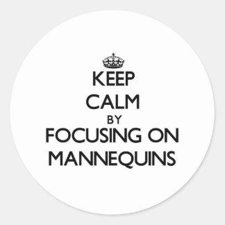 Keep Calm by focusing on Mannequins Round Sticker