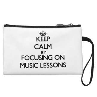 Keep Calm by focusing on Music Lessons Wristlet Clutch