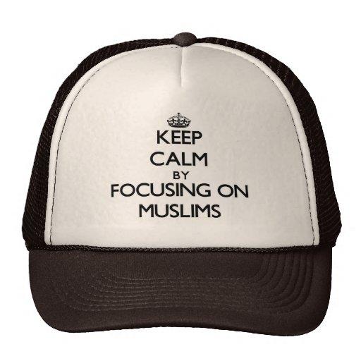 Keep Calm by focusing on Muslims Trucker Hats