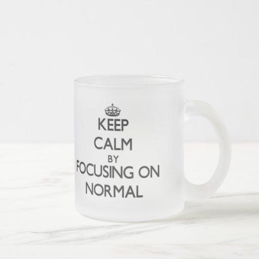 Keep Calm by focusing on Normal Coffee Mug