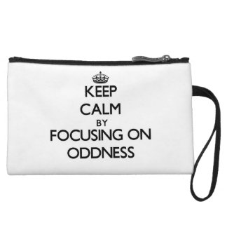 Keep Calm by focusing on Oddness Wristlet Purse