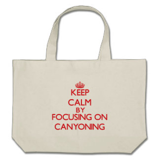 Keep calm by focusing on on Canyoning Tote Bags