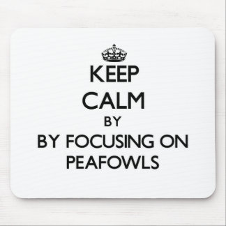Keep calm by focusing on Peafowls Mouse Pads