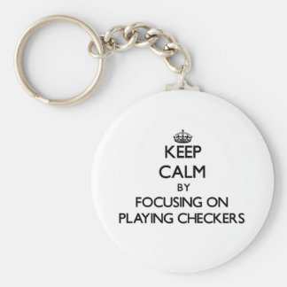 Keep Calm by focusing on Playing Checkers Key Chains