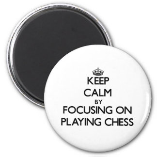Keep Calm by focusing on Playing Chess Refrigerator Magnet