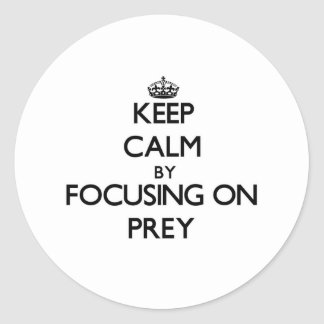 Keep Calm by focusing on Prey Round Stickers
