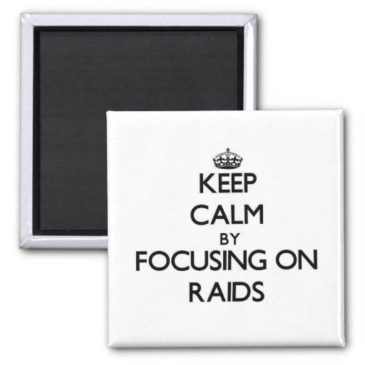 Keep Calm by focusing on Raids Refrigerator Magnets