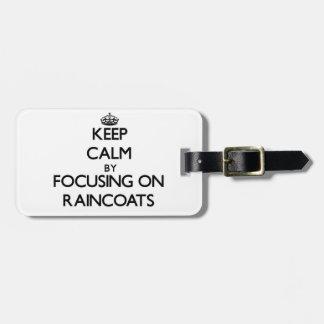 Keep Calm by focusing on Raincoats Luggage Tag