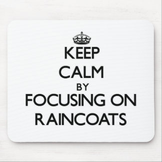 Keep Calm by focusing on Raincoats Mouse Pads