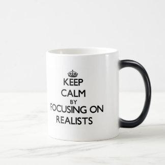Keep Calm by focusing on Realists Coffee Mugs