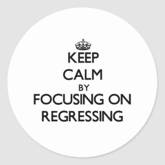 Keep Calm by focusing on Regressing Classic Round Sticker