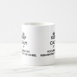 Keep Calm by focusing on Reinventing The Wheel Basic White Mug