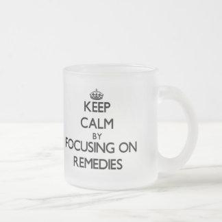 Keep Calm by focusing on Remedies Mugs