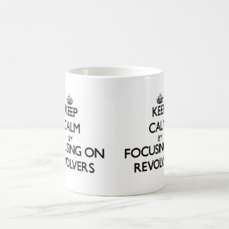 Keep Calm by focusing on Revolvers Mugs