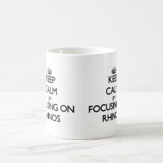 Keep Calm by focusing on Rhinos Coffee Mugs