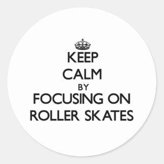 Keep Calm by focusing on Roller Skates Round Sticker