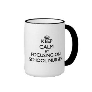 Keep Calm by focusing on School Nurses Mug