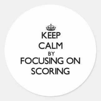 Keep Calm by focusing on Scoring Round Sticker