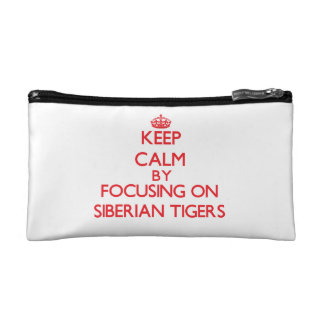 Keep calm by focusing on Siberian Tigers Cosmetic Bags