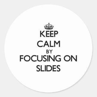 Keep Calm by focusing on Slides Sticker