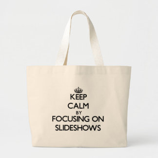 Keep Calm by focusing on Slideshows Tote Bags