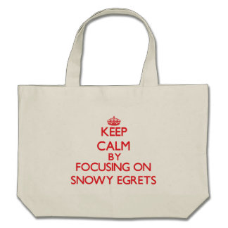 Keep calm by focusing on Snowy Egrets Canvas Bags