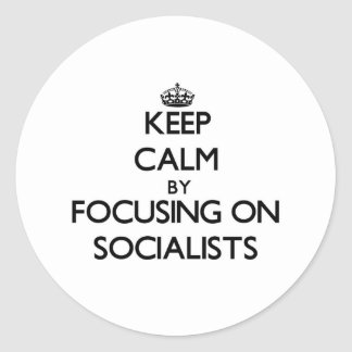 Keep Calm by focusing on Socialists Round Sticker
