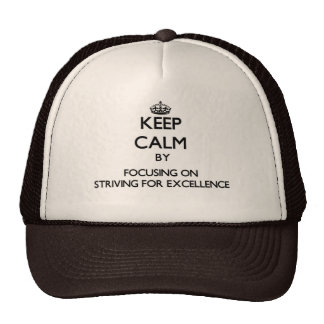 Keep Calm by focusing on Striving For Excellence Trucker Hats