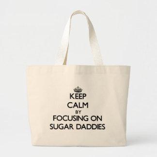 Keep Calm by focusing on Sugar Daddies Tote Bags