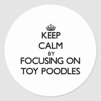Keep Calm by focusing on Toy Poodles Sticker