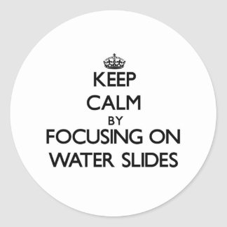 Keep Calm by focusing on Water Slides Round Sticker