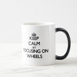 Keep Calm by focusing on Wheels Mugs