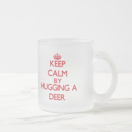 Keep calm by hugging a Deer Coffee Mugs