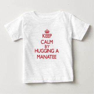 Keep calm by hugging a Manatee Tees