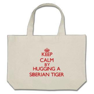 Keep calm by hugging a Siberian Tiger Canvas Bag