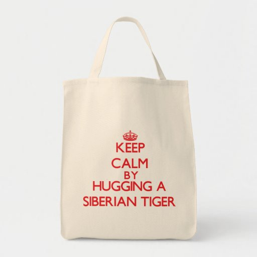 Keep calm by hugging a Siberian Tiger Tote Bags