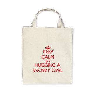 Keep calm by hugging a Snowy Owl Bag