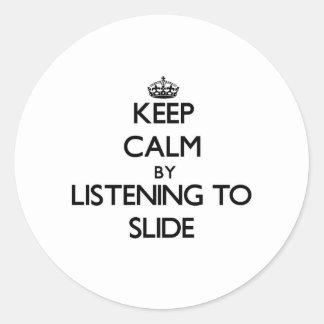 Keep calm by listening to SLIDE Round Sticker