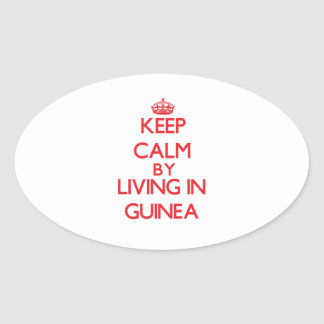 Keep Calm by living in Guinea Oval Stickers