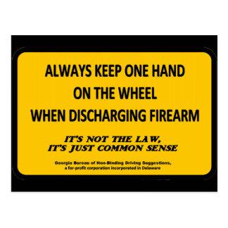 Keep one hand on the wheel when firing your gun postcard