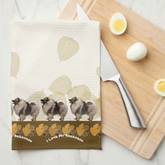 Keeshond on Tan Leaves and Pawprints Tea Towel