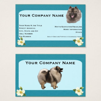 Keeshond on teal with dogwwood flower business card