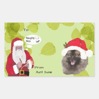 Keeshond with Santa makin His Naughty or Nice List Rectangular Sticker